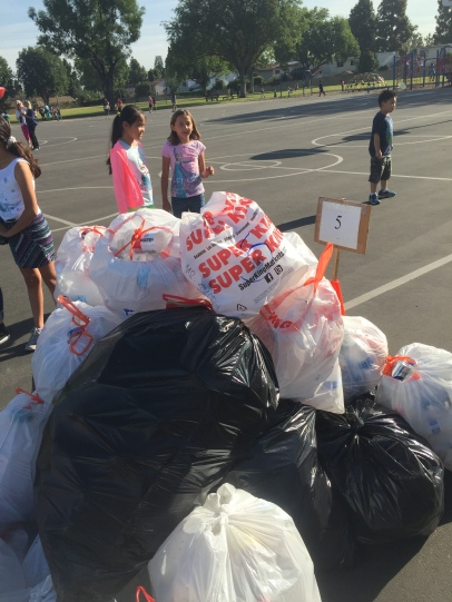 Elementary school students from Carver Academy in Cerritos collect recyclables for Earth Day